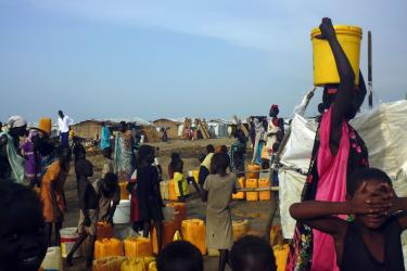 People gathered around water and supplies