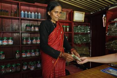 Harikala handling money during a transaction in her shop