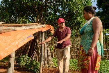 Mercy corps' agriculture specialist with santu
