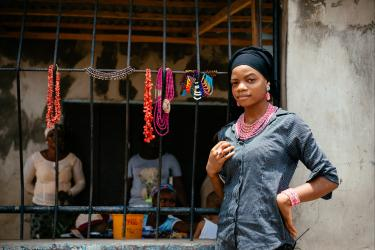 Woman in nigeria by a storefront
