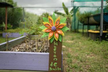 A decorative flower sign in the community garden