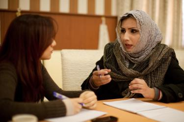 Two Iraqi woman in discussion.