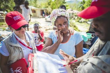Mercy corps employees work with haitian woman