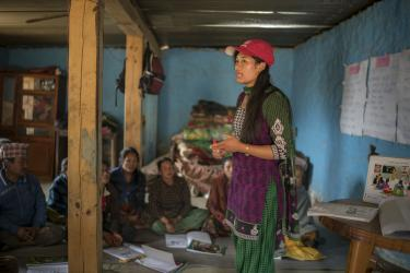 Mercy corps employee speaks to nepalese community group.
