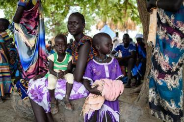 A woman with two children in south sudan