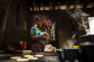 A woman making tortillas in guatemala