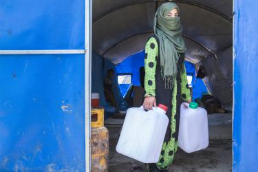 When fighting broke out, 15-year-old Freeal left her farm with her family and ran to a displacement camp, where they have lived since January. Now she and her siblings wait in line each morning and evening for water, using jerrycans her family received as part of a Mercy Corps distribution.