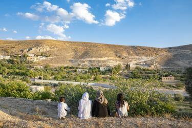 Farat and her daughters look from lebanon toward the hills that mark the syrian border