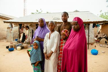 A family standing outdoors in nigeria