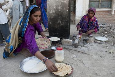 Women cooking flatbread in pakistan