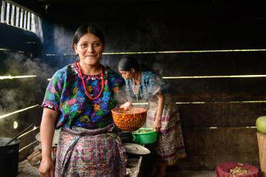 Two women cooking in Guatemala. Photo: Miguel Samper for Mercy Corps