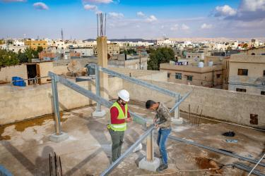 Construction workers on a rooftop in amman, jordan.