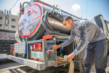 Palestinian water tender truck and its operator.