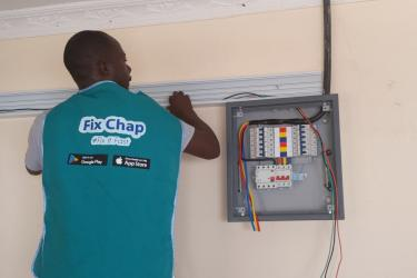 A person works with electrical equipment in kenya.