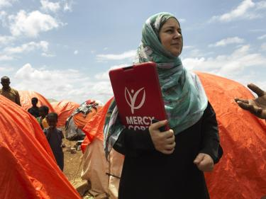 Mercy corps employee in somalia, holding clipboard