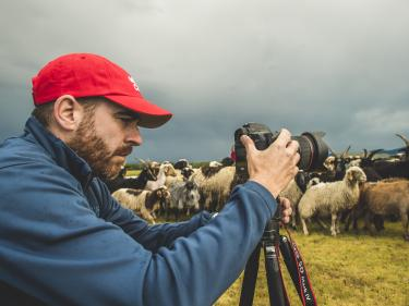 Ezra millstein, senior content producer, captures mercy corps' impact on people and communities with his camera. here, he photographs herders in altan-ovoo, mongolia, working with us to keep their cattle, sheep and other animals free of insects and disease. photo: sean sheridan for mercy corps