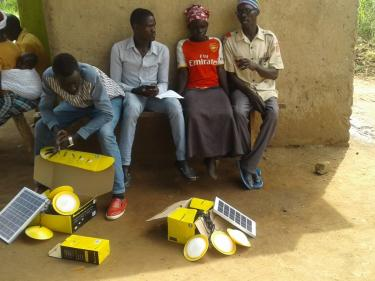 People with unboxed solar energy supplies