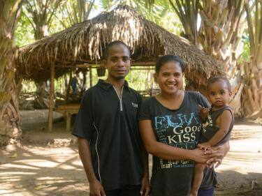 A man and woman holding a baby in timor leste