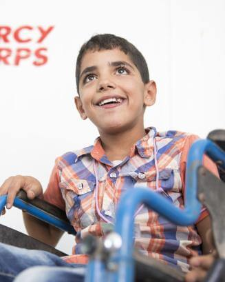 boy in Jordan in a wheelchair